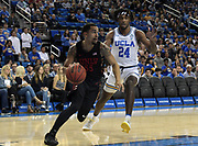 Nov 15, 2019; Los Angeles, CA, USA; UNLV Rebels guard Elijah Mitrou-Long (55) is defended by UCLA Bruins forward Jalen Hill (24) in the first half at Pauley Pavilion. UCLA defeated UNLV 71-54.