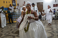 RIO DE JANEIRO, BRAZIL - JANUARY 24: Denise Linhares performs a ritual in a candomble ceremony, in Rio de Janeiro, Brazil, on Saturday, Jan. 23, 2015. Brazil's Afro-Brazilian religions which in recent years have come under increasing threats and prejudice, particularly from the growing number of evangelical churches. Candombl&eacute; originated in Salvador, Bahia at the beginning of the 19th century when enslaved Africans brought their beliefs with them. Umbanda and candombl&eacute; are Afro-Brazilian religions practiced in mostly Brazil. <br /> (Lianne Milton for the Washington Post)