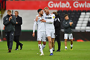 Matt Grimes (21) of Swansea City and  Oli McBurnie (9) of Swansea City celebrate to 2-0 win over Reading at full time during the EFL Sky Bet Championship match between Swansea City and Reading at the Liberty Stadium, Swansea, Wales on 27 October 2018.