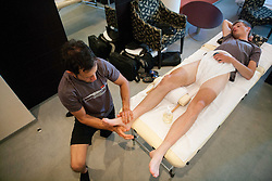 Physiotherapist Benjamin Trontelj and Tomaz Nose of KK Adria Mobil during massage in Austria Trend Hotel One day before the 20th Tour de Slovenie 2013,  on June 12, 2013 in Ljubljana, Slovenia. (Photo By Vid Ponikvar / Sportida)