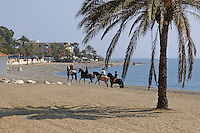 Riders on the beach at San Pedro de Alcantara, Marbella, Malaga, Province, Spain, March 2015, 201503140563<br /> <br /> Copyright Image from Victor Patterson, 54 Dorchester Park, Belfast, UK, BT9 6RJ<br /> <br /> t: +44 28 9066 1296<br /> m: +44 7802 353836<br /> vm +44 20 8816 7153<br /> <br /> e1: victorpatterson@me.com<br /> e2: victorpatterson@gmail.com<br /> <br /> www.victorpatterson.com<br /> <br /> IMPORTANT: Please see my Terms and Conditions of Use at www.victorpatterson.com