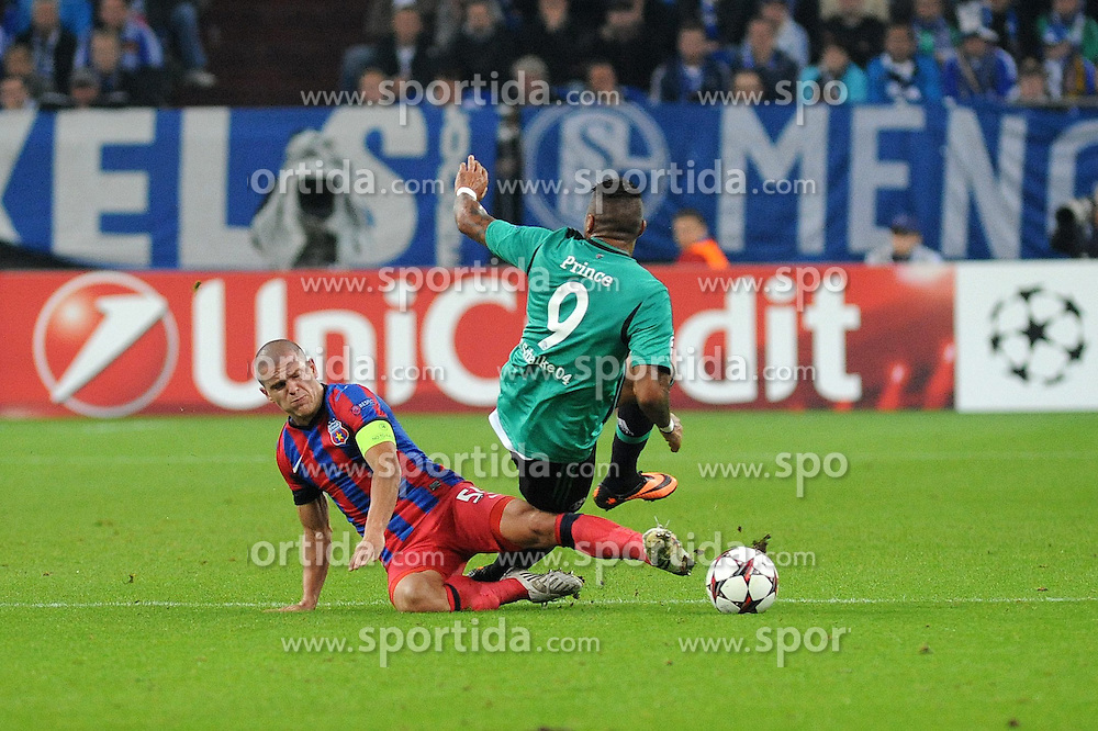 18.09.2013, Veltins Arena, Gelsenkirchen, GER, UEFA Champions League, Schalke 04 vs Steaua Bukarest, Gruppe E, im Bild Kevin Prince Boateng ( rechts Schalke 04 ) im Zweikampf mit Alexandru Bourceanu ( links Steaua Bukarest/ Action/ Aktion ), //  during UEFA Champions League group E match between Schalke 04 vs Steaua Bukarest at the Veltlins Arena, Gelsenkirchen, Germany on 2013/09/18. EXPA Pictures &copy; 2013, PhotoCredit: EXPA/ Eibner/ Thomas Thienel<br /> <br /> ***** ATTENTION - OUT OF GER *****