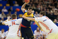 Joan Canellas of Spain between Drago Vukovic of Croatia and Jakov Gojun of Croatia during handball match between Spain and Croatia in  Main Round of 10th EHF European Handball Championship Serbia 2012, on January 22, 2012 in Spens Hall, Novi Sad, Serbia.  (Photo By Vid Ponikvar / Sportida.com)