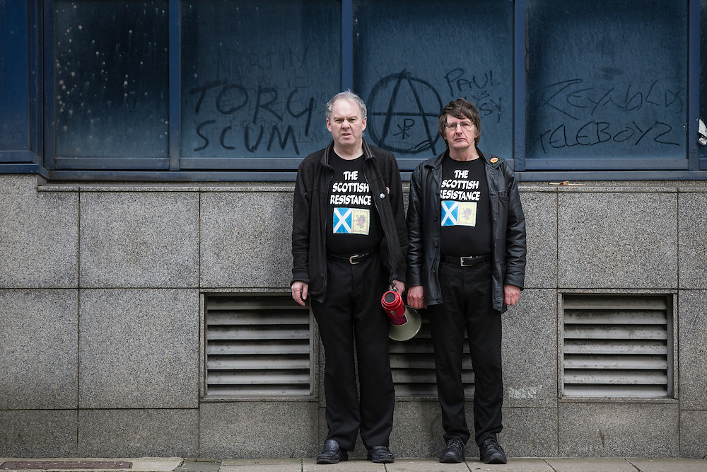 Sean Clerkin (L) of the Scottish Resistance at a demo in Cadogan Street, Glasgow. With fellow member James Scott (R).  Picture Robert Perry 29th Jan 2016<br /> <br /> Must credit photo to Robert Perry<br /> FEE PAYABLE FOR REPRO USE<br /> FEE PAYABLE FOR ALL INTERNET USE<br /> www.robertperry.co.uk<br /> NB -This image is not to be distributed without the prior consent of the copyright holder.<br /> in using this image you agree to abide by terms and conditions as stated in this caption.<br /> All monies payable to Robert Perry<br /> <br /> (PLEASE DO NOT REMOVE THIS CAPTION)<br /> This image is intended for Editorial use (e.g. news). Any commercial or promotional use requires additional clearance. <br /> Copyright 2014 All rights protected.<br /> first use only<br /> contact details<br /> Robert Perry     <br /> 07702 631 477<br /> robertperryphotos@gmail.com<br /> no internet usage without prior consent.         <br /> Robert Perry reserves the right to pursue unauthorised use of this image . If you violate my intellectual property you may be liable for  damages, loss of income, and profits you derive from the use of this image.