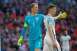LONDON, ENGLAND - Sunday, March 26, 2017: England's goalkeeper Joe Hart giving high-five to teammate John Stones during the 2018 FIFA World Cup Qualifying Group F match against Lithuania at Wembley Stadium. (Pic by Lexie Lin/Propaganda)