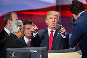 Republican Presidential candidate Donald J. Trump and Trump campaign manager Paul Manafort (in the back) on stage to do sound check ahead of the acceptance speach at The Republican National Convention in Cleveland.