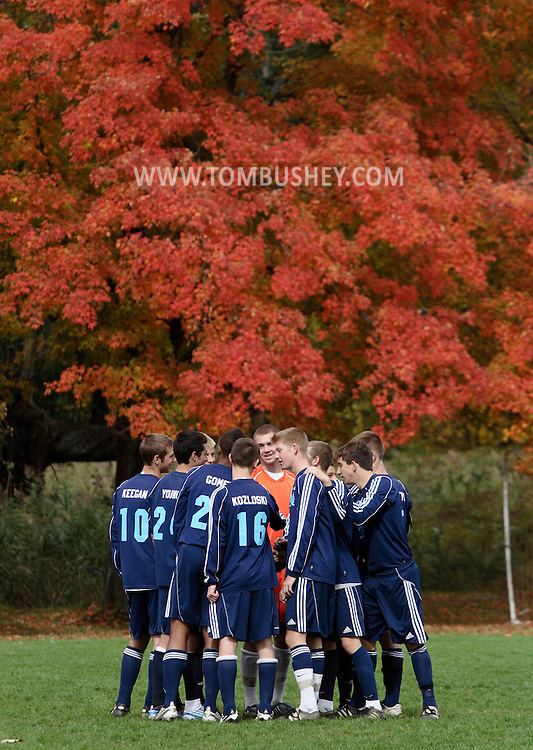 Beacon, New York - John Jay East Fishkill soccer players huddle on he field before playing Beacon in a high school boys' soccer game on Oct. 16, 2010. ©Tom Bushey / The Image Works