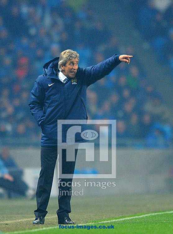 Manchester City manager Manuel Pellegrini gesticulates during the UEFA Champions League match at the Etihad Stadium, Manchester<br /> Picture by Greg Kwasnik/Focus Images Ltd +44 7902 021456<br /> 05/11/2014