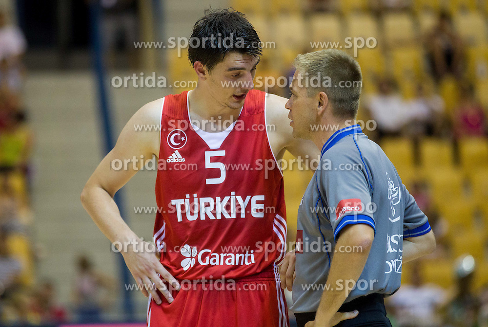 Emir Preldzic of Turkey and referee Damir Javor during friendly match between National teams of Slovenia and Turkey for Eurobasket 2013 on August 4, 2013 in Arena Zlatorog, Celje, Slovenia. (Photo by Vid Ponikvar / Sportida.com)