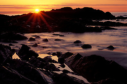 Sunrise over the Atlantic Ocean from the rocky coast.  Wallis Sands State Park, Rye, NH