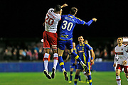 Jake Beesley and Michael Ihiekwe compete for the ball during the The FA Cup match between Solihull Moors and Rotherham United at the Automated Technology Group Stadium, Solihull, United Kingdom on 2 December 2019.