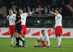 VIENNA, AUSTRIA - WEDNESDAY MARCH 30th 2005: Wales' players argue with referee Manuel Mejuto Gonzalez as Craig Bellamy sits injured against Austria during the World Cup Qualifying Group Six match at the Ernst Happel Stadium. (Pic by David Rawcliffe/Propaganda)