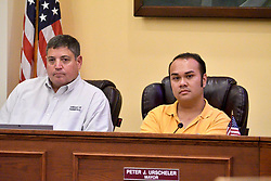 Mayor Peter Ursucheler (right) listens as consultant Thomas Frawley and developer Manny DeMutis present plans for the extension of rail commuter service from Philadelphia to Phoenixville, at a borough meeting in Phoenixville, PA, on August 21, 2018. (Bastiaan Slabbers for WHYY)