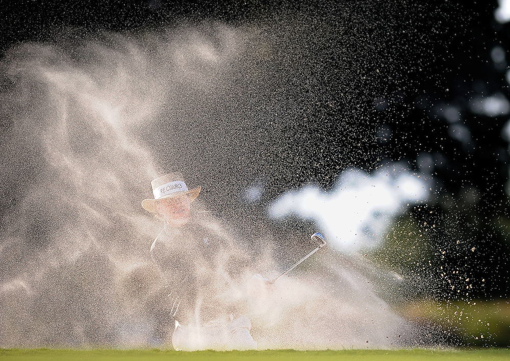 Briny Baird hits out of the bunker on the 15th green during the third round of the McGladrey Classic golf tournament on Saturday, Nov. 9, 2013, in St. Simons Island, Ga. (AP Photo/Stephen Morton)