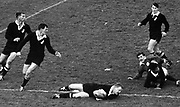 All Black hooker Bruce McLeod scores the All Blacks' first try of the 1966 series in the first test at Carisbrook against the Lions. Others pictured are, from left, Kel Tremain, Brian Lochore, Lions halfback R. Young, Waka Nathan and Spooky Smith.<br /> Photosport