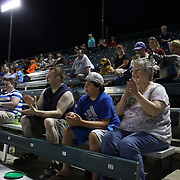 Eric Noel, (left), Connor Noel and Sue Noel, watch a fly ball during the New Britain Rock Cats Vs Binghamton Mets Minor League Baseball game at New Britain Stadium, New Britain, Connecticut, USA. 2nd July 2014. Photo Tim Clayton