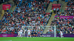 COVENTRY, ENGLAND - Friday, August 3, 2012: Canada's captain Christine Sinclair (#12) scores the second goal from a free-kick during the Women's Football Quarter-Final match between Great Britain and Canada, on Day 7 of the London 2012 Olympic Games at the Rioch Arena. Canada won 2-0. (Photo by David Rawcliffe/Propaganda)