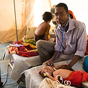 Dr Elghassoum Wane with Chekina Ould Talab, who is suffering from pneumonia, at a Médecins Sans Frontières (MSF) health centre at the Mbera camp for Malian refugees in Mauritania, on 5 March 2013.