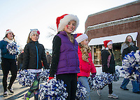 Young ladies from Lakes Region Gymnastics march down Main Street ushering in some Christmas spirit during the annual Holiday Parade on Saturday afternoon.  (Karen Bobotas/for the Laconia Daily Sun)
