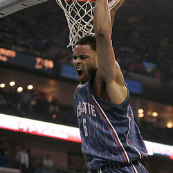 Apr 07, 2010; New Orleans, LA, USA; Charlotte Bobcats center Tyson Chandler (6) reacts after dunking the ball against the New Orleans Hornets during the first half at the New Orleans Arena. Mandatory Credit: Derick E. Hingle-US PRESSWIRE