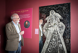 © Licensed to London News Pictures. 16/04/2018. Winchcombe, Gloucestershire, UK. Sudeley Castle's 'Royal Sudeley 1,000, Trials, Triumphs and Treasures'. DEREK MADDOCK, Archivist at the castle, with life-size glass-engraved portrait of Katherine Parr by critically acclaimed artist, John Hutton. Treasures from Sudeley Castle's 1,000 year history have gone on show in a new exhibition. Called 'Royal Sudeley 1,000, Trials, Triumphs and Treasures', the newly refurbished exhibition includes a collection of priceless objects and curiosities. The exhibition includes a one-of-a-kind, life-size glass-engraved portrait of Katherine Parr by critically acclaimed artist, John Hutton. The artwork was re-discovered during the refurbishment of a holiday cottage on the estate, where it had been for decades. Its importance has now been realised and so it has been brought into the exhibition collection. Numerous items of historic significance are also on display, such as a lock of Katherine Parr's hair, her prayer book and an intricate lace christening canopy believed to have been worked on by Anne Boleyn for the christening of her daughter, Elizabeth I. Sudeley was a royal residence, closely associated with some of the most famous English monarchs, including Edward IV, Richard III, Henry VIII, Lady Jane Grey, Katherine Parr, Elizabeth I and Charles I. The Castle was even home to a secret Queen of England, Eleanor Boteler, whose royal status was unknown for centuries. Photo credit: Simon Chapman/LNP