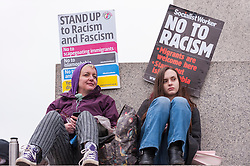 © Licensed to London News Pictures. 21/03/2015. Trafalgar Square, London UK. Large crowds carrying banners and placards assemble in Trafalgar Square for the Stand Up to Racism and Fascism rally. Photo credit : Stephen Chung/LNP