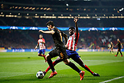 AS Roma's Dutch midfielder Kevin Strootman vies for the ball with Atletico Madrid's Ghanaian midfielder Thomas during the UEFA Champions League, Group C football match between Atletico Madrid and AS Roma on November 22, 2017 at the Wanda Metropolitano in Madrid, Spain - Photo Benjamin Cremel / ProSportsImages / DPPI