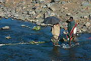 GONDAR/ETHIOPIA..On the road from Gondar to Bahar Dar..Villagers crossing a river..(Photo by Heimo Aga)