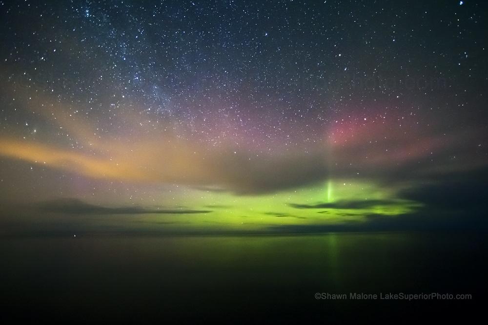 aurora and Milky Way reflecting off Lake Superior
