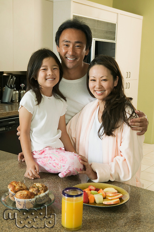 Family at kitchen table with breakfast portrait