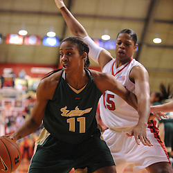 Jan 31, 2009; Piscataway, NJ, USA; Rutgers center Kia Vaughn (15) defends South Florida forward Porche Grant (11) on an inbound play during the second half of South Florida's 59-56 victory over Rutgers in NCAA women's college basketball at the Louis Brown Athletic Center