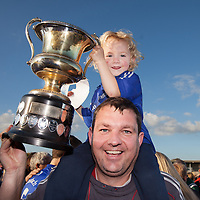 Laurence O'Doherty and his son Óisin celebrate  with the cup after Cratloe's Senior Football Final win