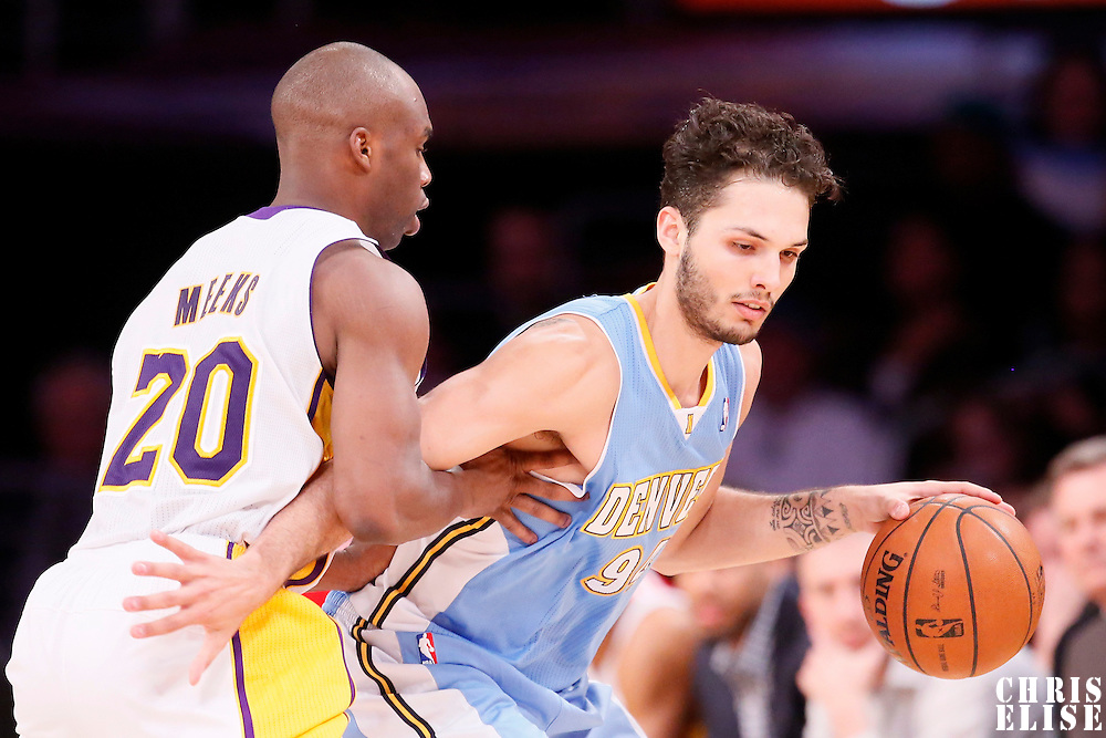05 January 2014: Denver Nuggets shooting guard Evan Fournier (94) drives past Los Angeles Lakers shooting guard Jodie Meeks (20) during the Denver Nuggets 137-115 victory over the Los Angeles Lakers at the Staples Center, Los Angeles, California, USA.