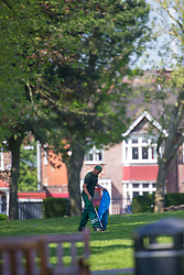 A worker in Roundwood Park, Brent, picks up litter following the hottest May bank holiday weekend on record, park workers have their work cut out creating up the mess left behind by picnickers. London, May 08 2018.