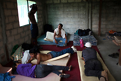 A group of migrants relax in a shelter in Tenosique, Tabasco.  Tenosique is the starting point for migrants who will travel on top of a freight train north to the border with the United States.  The trip for these migrants, mostly from Central America,  has become increasingly dangerous over the past several years as Mexico's drug war has raged and kidnappings and killings of migrants has increased.