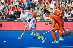 England's Iain Lewers is shadowed by Robbert Kemperman of the Netherlands. England v Netherlands  - Unibet EuroHockey Championships, Lee Valley Hockey & Tennis Centre, London, UK on 23 August 2015. Photo: Simon Parker