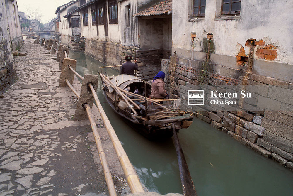 Boat and traditional architecture on the Grand Canal in the water town, Suzhou, Jiangsu Province, China.