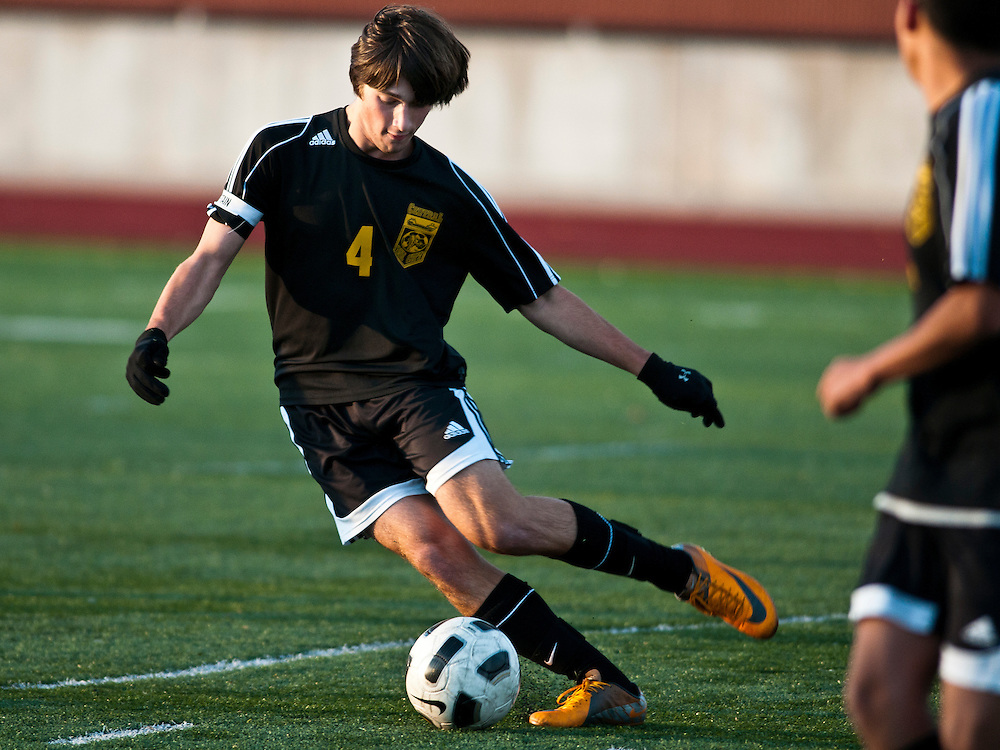 Lathan Goumas   The Bay City Times..Collin Richard of Bay City Central High School dribbles the ball during a district tournament soccer game at Midland High School on Monday.