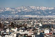 Photo shows the mountains surrounding Aizuwakamatsu City, Fukushima Prefecture, Japan.  Photographer: Rob Gilhooly