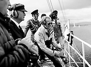 President Patrick Hillery watches the yachts depart after firing the starting cannon to start the Round Europe Yacht Race. Beginning at Dún Laoghaire, the first leg of the race will take the boats to Lorient, France.<br />