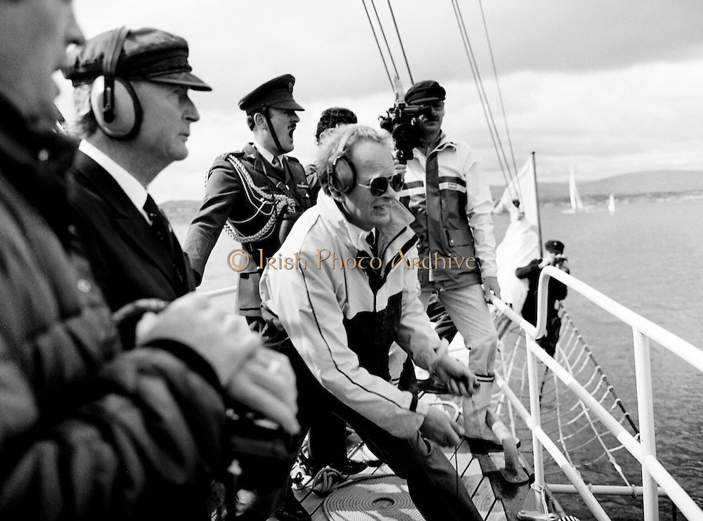 President Patrick Hillery watches the yachts depart after firing the starting cannon to start the Round Europe Yacht Race. Beginning at D&uacute;n Laoghaire, the first leg of the race will take the boats to Lorient, France.<br />