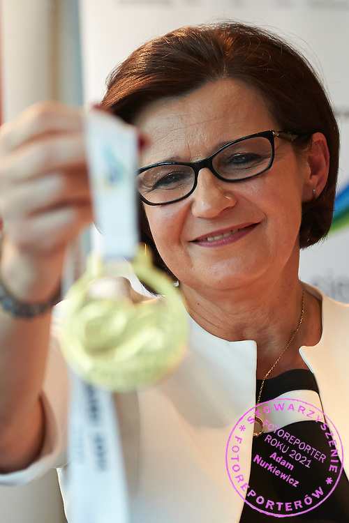 Anna Wasilewska member of board of Warmia Mazury Region holds gold medal during press conference at Polish Olympic Committee in Warsaw, Poland.<br /> <br /> Poland, Warsaw, August 27, 2014<br /> <br /> Picture also available in RAW (NEF) or TIFF format on special request.<br /> <br /> For editorial use only. Any commercial or promotional use requires permission.<br /> <br /> Photo by &copy; Adam Nurkiewicz / Mediasport