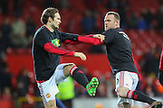 Daley Blind of Manchester United and Wayne Rooney of Manchester United in the warm up during the Barclays Premier League match between Manchester United and Stoke City at Old Trafford, Manchester, England on 2 February 2016. Photo by Phil Duncan.