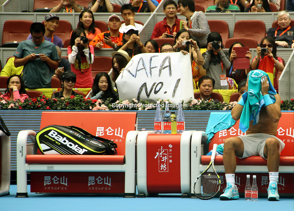 Oct 05, 2013; Beijing, CHINA; Rafael Nadal of Spain was in a men's semifinal match against Tomas Berdych of Czech for less than an hour at the Tennis China Open. The match ended prematurely after Berdych injured his back and retired when Nadal was leading 4-2 in the opening set.