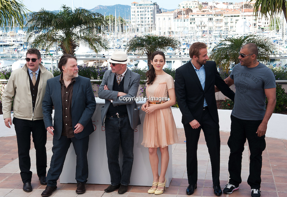 Jacques Audiard ,Marion Cotillard &Matthias Schoenaerts at the photo call of De Rouille ET D'os at Cannes 65th Film Festival Thursday 17th May 2012.  Photo by i-Images.
