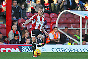 Brentford's Jake Bidwell on the ball during the Sky Bet Championship match between Brentford and Derby County at Griffin Park, London, England on 1 November 2014.
