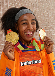 06-10-2019 QAT: World Champion Sifan Hassan, Doha<br /> Sifan Hassan poses with the gold medals of the 10,000 meters and 1500 meters she has won at the World Athletics Championships.