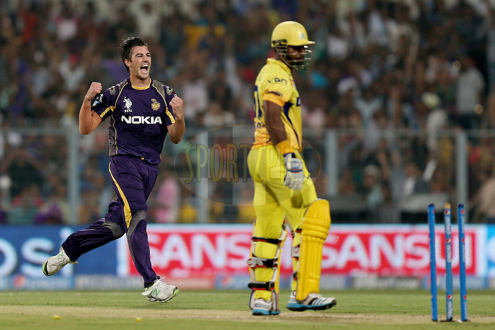 Pat Cummins celebrates the wicket of Dwayne Smith during match 47 of the Pepsi Indian Premier League Season 2014 between the Kolkata Knight Riders and the Chennai Superkings held at the Eden Gardens Cricket Stadium, Hyderabad, India on the 20th May  2014. Photo by Jacques Rossouw / IPL / SPORTZPICS<br /> <br /> <br /> <br /> Image use subject to terms and conditions which can be found here:  http://sportzpics.photoshelter.com/gallery/Pepsi-IPL-Image-terms-and-conditions/G00004VW1IVJ.gB0/C0000TScjhBM6ikg