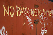 A notice not to park in front of a scrap metal yard, with a threat of clamping, has been painted on to gates in a Bristol industrial wasteland.