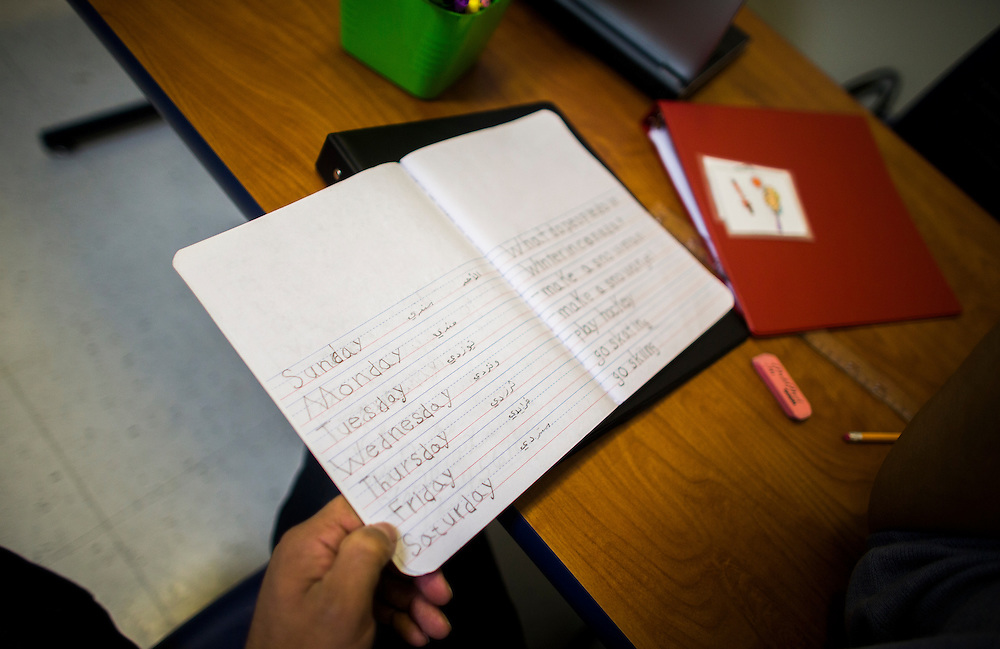 A writing book shows words written in English and Arabic by a Syrian refugee  during English lessons at the Loyola School of Adult and Continuing Education in Bellville, Ontario, Canada, Wednesday January 20, 2016.   (Mark Blinch for the BBC)